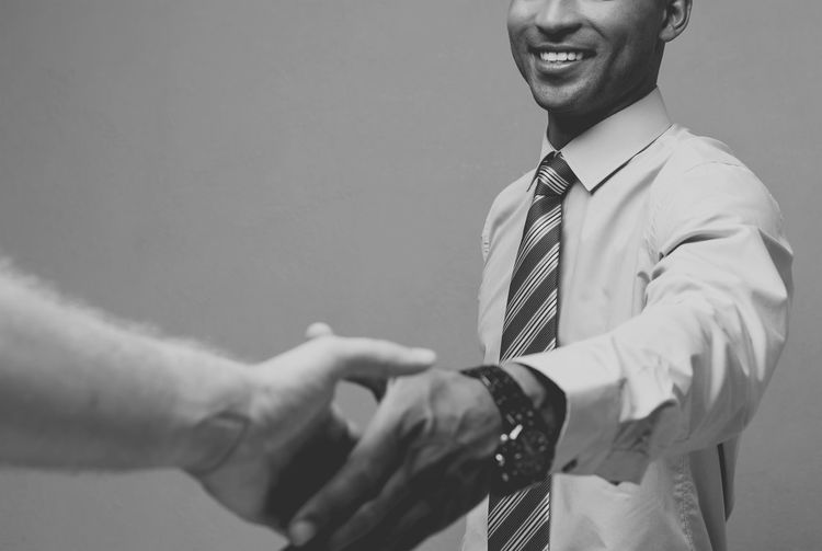 Midsection of businessman shaking hand