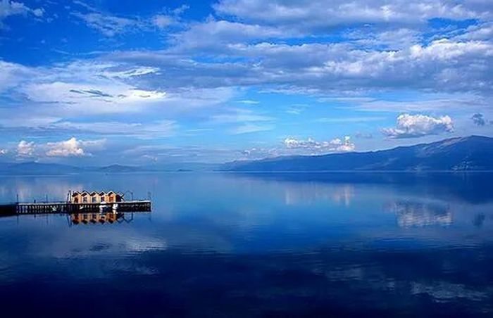 Pogradec Albania Water Reflections Water Tranquil Scene Tranquility Sky Lake Scenics Waterfront Mountain Reflection Beauty In Nature Cloud - Sky Mountain Range Nature Idyllic Cloud Calm Sea Pier Blue Built Structure