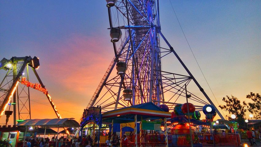 Amusement Park Arts Culture And Entertainment Amusement Park Ride Fun Rollercoaster Sky Sunset Ferris Wheel Leisure Activity Multi Colored Carousel Childhood No People Outdoors Day