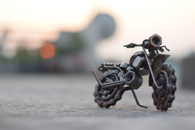 Close-up of toy bicycle on table