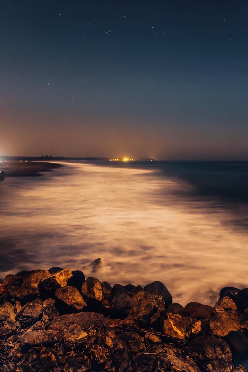 water, sky, sea, rock, scenics - nature, beauty in nature, solid, tranquility, tranquil scene, nature, rock - object, night, beach, land, space, horizon over water, no people, horizon, star - space, astronomy, outdoors