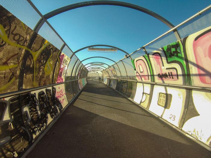 Graffiti on bridge against sky