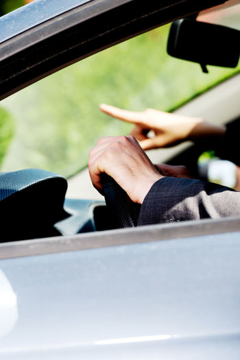 Close-up of human hand in car