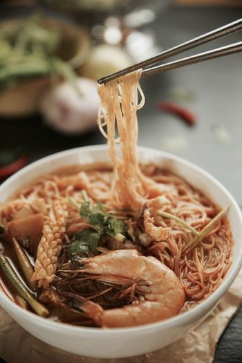 Close-up of noodles served in bowl on table