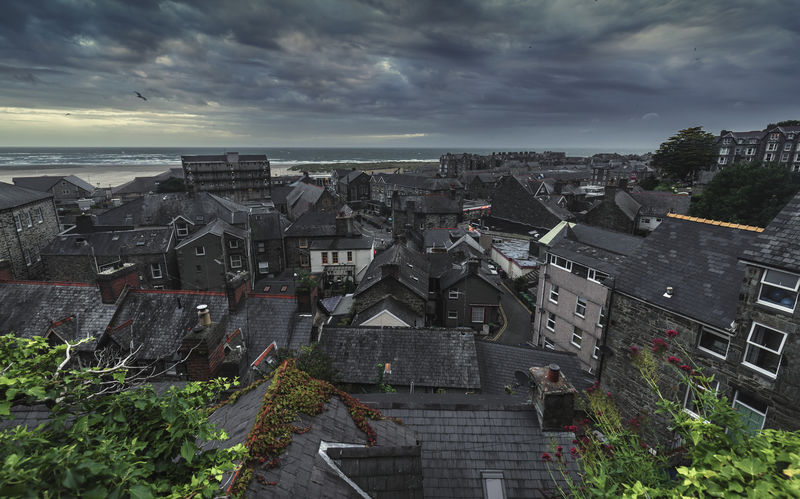 Aerial View of Historic Coastal Town of Barmouth in North Wales Cloudy Sky Coastline Dramatic Sky Landscape_Collection Aerial View Architecture Building Exterior Built Structure City Cityscape Cloud - Sky Coastal Landscape Coastal Town Day High Angle View Horizon Over Water Landmark Nature No People Outdoors Sea Sky Summer