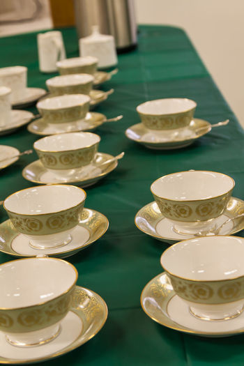 Arrangement Close-up Coffee Cup Coffee Cup And Saucer Day Gambling Chip Green Color Indoors  Luxury No People Row Of Coffee Cu