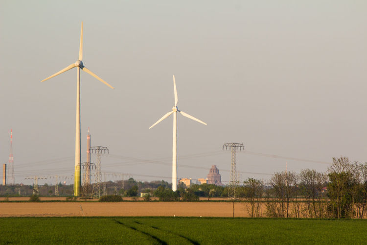 Alternative Energy Day Environmental Conservation Field Fuel And Power Generation Grass Industrial Windmill Nature No People Outdoors Renewable Energy Sky Tree Wind Power Wind Turbine Windmill