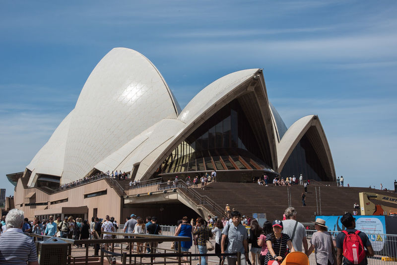 Sydney,NSW,Australia-November 20,2016: Sydney Opera House and Bar at Bennelong Point in Sydney, Australia. 20th Century Architecture Australia City Life City Break Façade Harbour Modern Architecture Roof Steps Sydney Opera House Tourist Tourist Attraction  Bennelong Point Crowd Crowded Famous Place Landmark Large Group Of People Lifestyles Real People Sky Sydney Tourism Travel Destinations