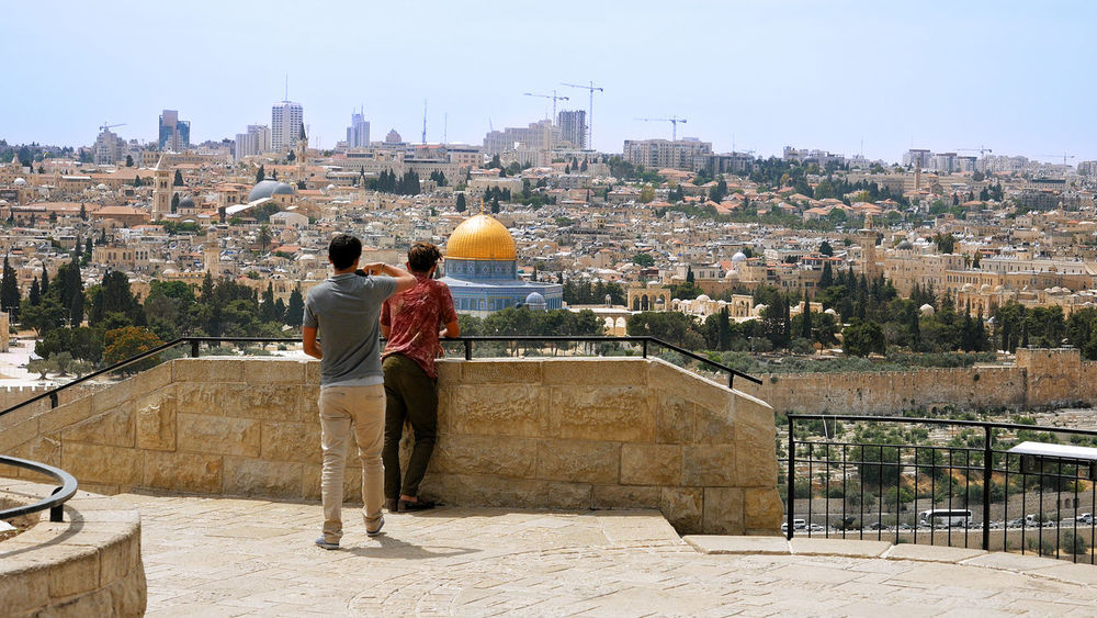 Al Aqsa Dome Of The Rock Palestine Adult Architecture Building Exterior Built Structure City Cityscape Clear Sky Day Full Length Israel Jerusalem Leisure Activity Lifestyles Men Outdoors People Real People Rear View Sky Togetherness Travel Destinations Two People An Eye For Travel