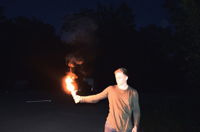 Casual night Real People Night Burning Flame One Person Outdoors Men Standing Lifestyles Riot People First Eyeem Photo EyeEmNewHere Blurred Face Censored