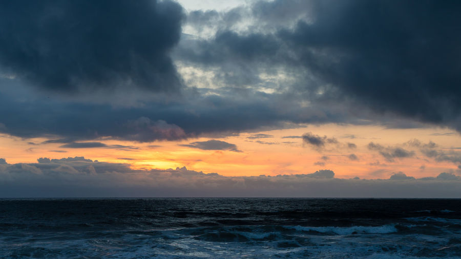 Dramatic sky with dark clouds at sunset over atlantic ocean in Portugal Atlantic Atlantic Ocean Copy Space Dark Clouds Portugal Rain Beach Cloud - Sky Clouds Dramatic Sky Furadouro Horizon Horizon Over Water Idyllic No People Oval Scenics - Nature Sea Sky Sunset Tranquil Scene