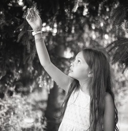 Girl holding twig at park