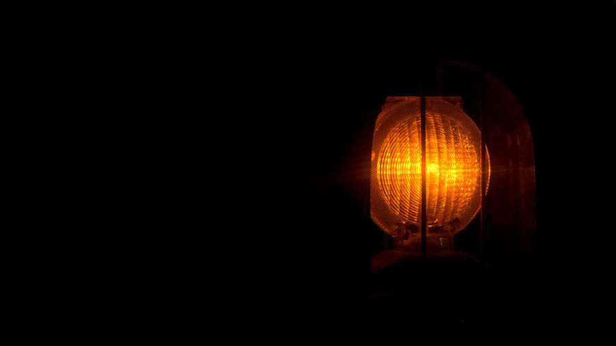 Lighting Equipment Illuminated Dark Single Object Copy Space Studio Shot Black Background No People Indoors  Close-up Glowing Orange Color Electricity  Light - Natural Phenomenon Domestic Room Darkroom Light Bulb Technology Night Cut Out Electric Lamp