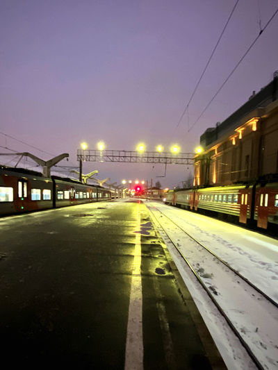 View of illuminated railroad tracks at night