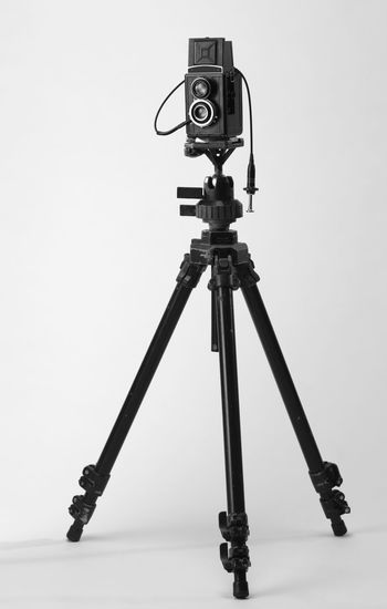 camera mounting on the tripod Camera Photography Multimedia Tripod Photograph Lens Equipment Photographic Theme Photographing Black Nobody White Background Twin Lense Medium Format Camera Old Antique Ancient Photography Themes Technology No People Camera - Photographic Equipment Studio Shot Photographic Equipment Indoors  Still Life Arts Culture And Entertainment Cable Cable Release Close-up Absence