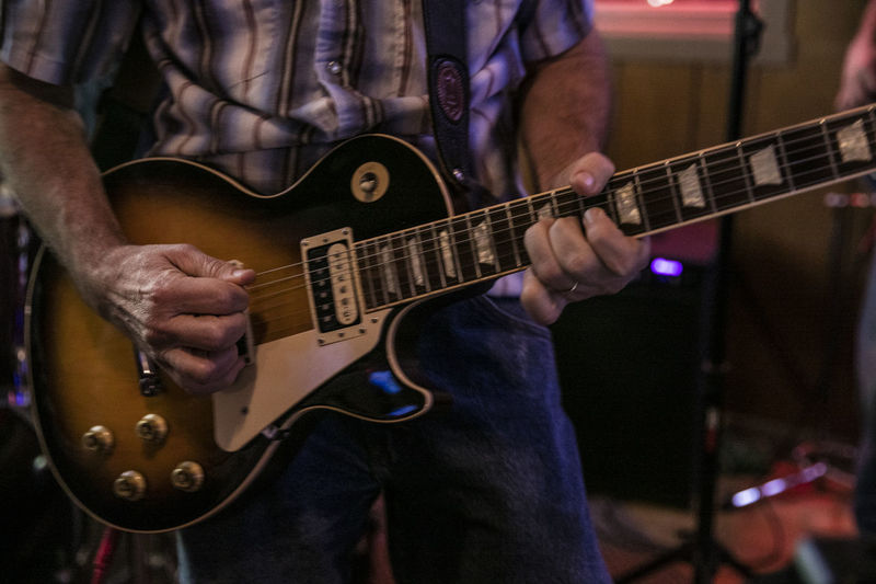 Midsection Of Musician Playing Electric Guitar