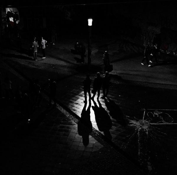 People And Places Street Night Lifestyles Shadow Men City Life High Angle View Street Light City Berlin Photography City Life Week On Eyeem City City Street Black And White Saturday Nightphotography Night Lights Streetphotography Streetlife Streetlights