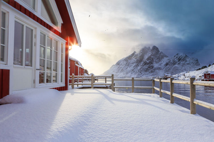 The fisherman village Sund on Lofoten Islands, Norway Architecture Barents Sea, Lofoten Islands, Northern, Sund, Town, Arctic, Atlantic, Coast, Cold, Europe, Fishing, Fjord, Harbor, Holiday, Ice, Landscape, Mountains, Nature, Nordic, Nordland, North, North Sea, Norway, Norwegian, Ocean, Outdoor, Outdoors, Polar Circle, P Beauty In Nature Cold Cold Temperature Day Frozen Landscape Mountain Nature No People Outdoors Scenics Sky Snow Tranquility Water Weather Winter