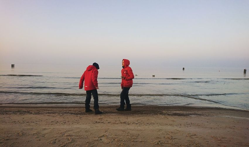Sea Beach Togetherness Two People Friendship Horizon Over Water Rear View Sky Water Red Outdoors People Real People Brothers Childhood Children Only Baltic Sea Betterlandscapes