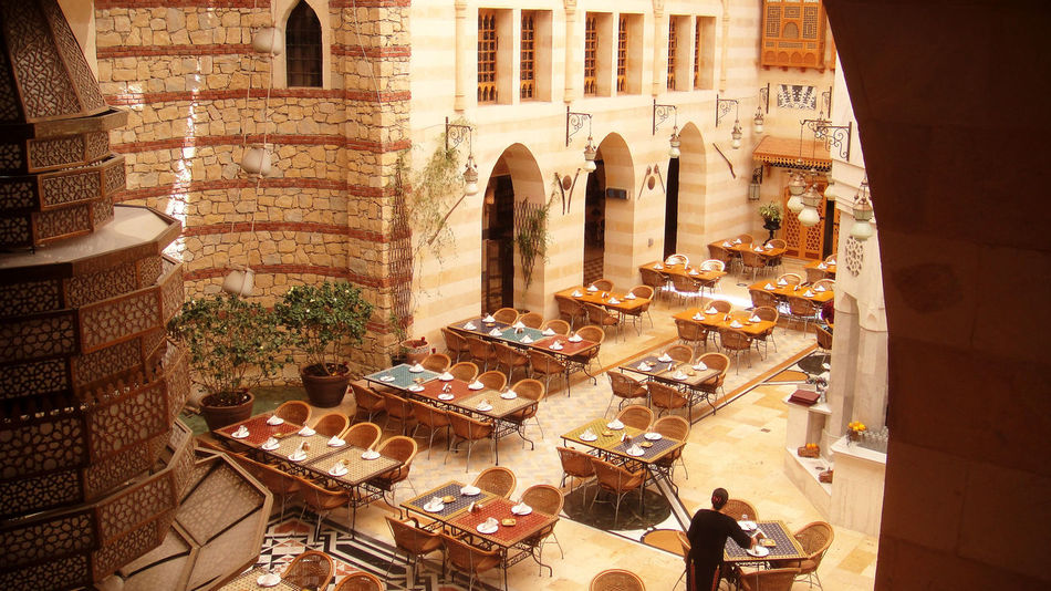 Before the opening hour... Arch Architecture Building Exterior Built Structure Culture Dubai High Angle View Lifestyles Person Place Setting Relaxation Restaurant Resting Retaurant Table Togetherness Travel