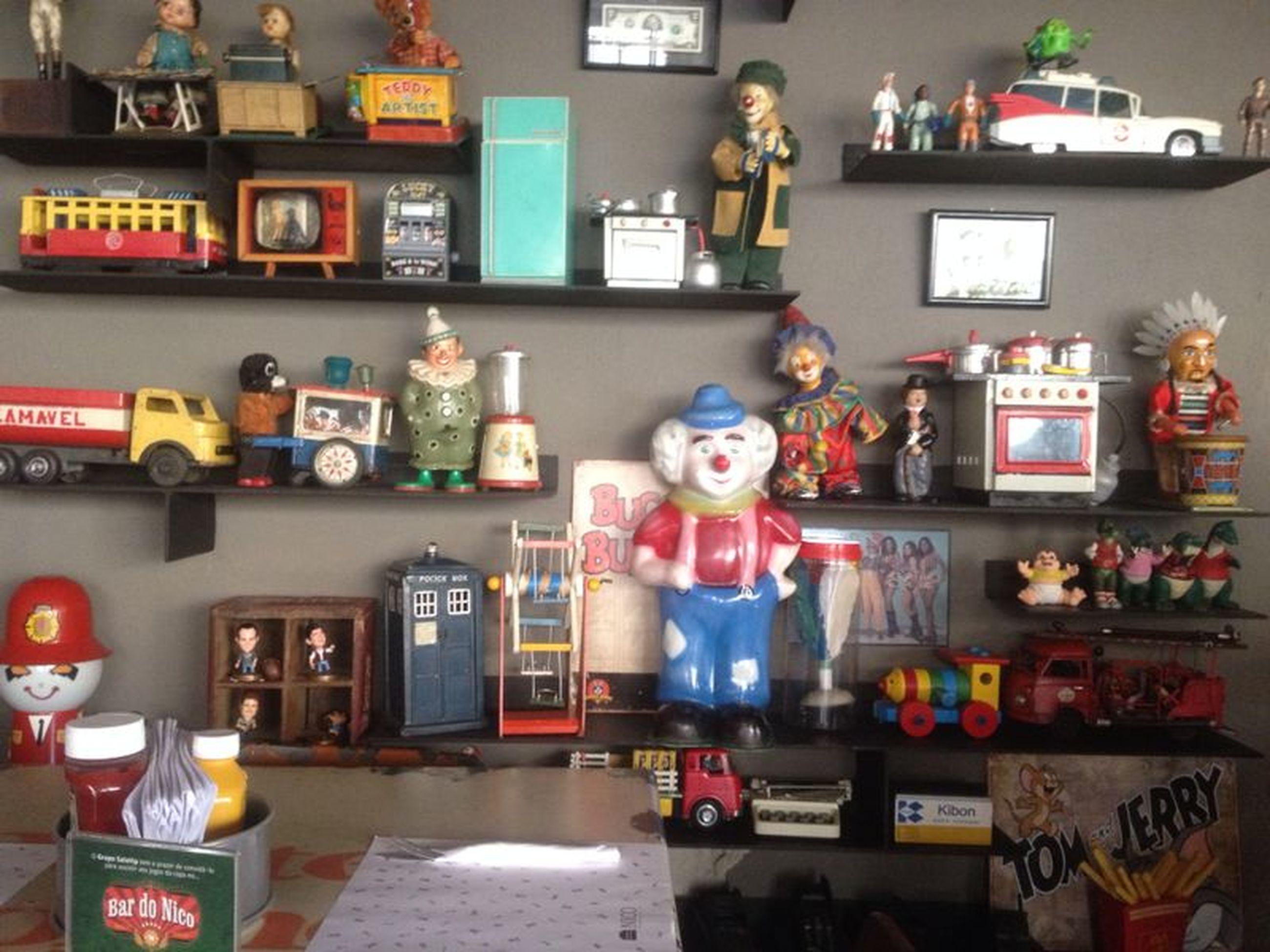 human representation, art, art and craft, creativity, indoors, statue, animal representation, text, store, sculpture, toy, communication, figurine, retail, variation, shop, mannequin, display