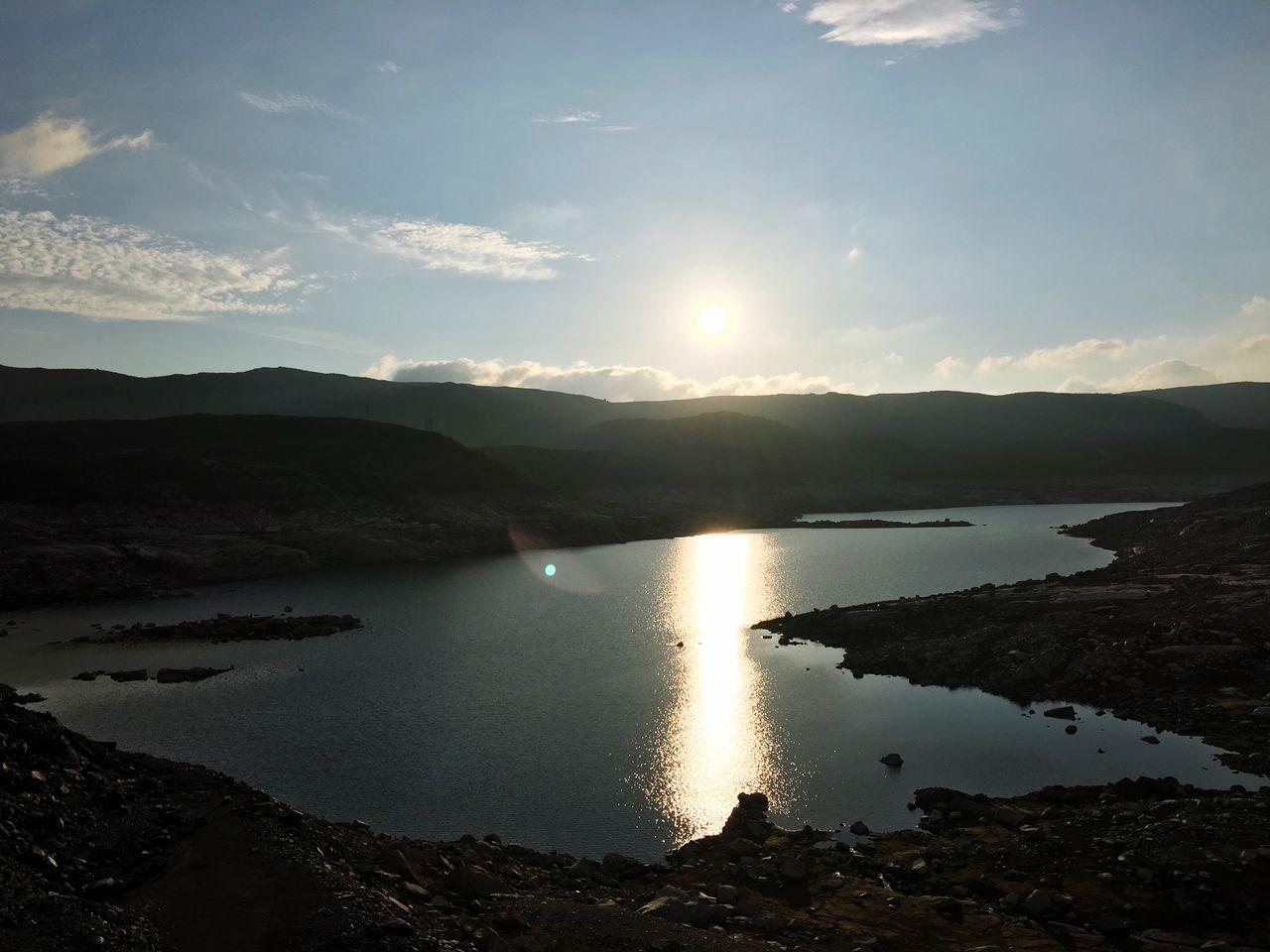Sun Shining Over Lake