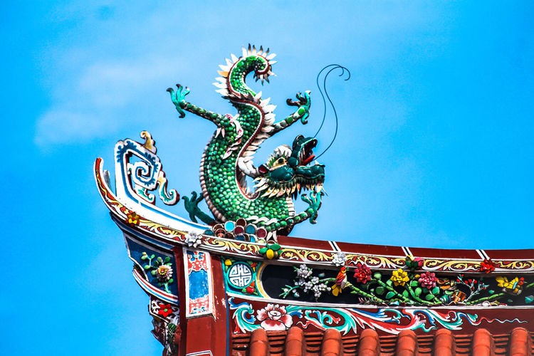 A section of Khoo Kongsi Blue Sky Architecture Dragon Sculpture Khoo Kongsi Tourist Attraction  Ancestral Place Penang Island Malaysia Travel Destinations Travel Chinese Architecture