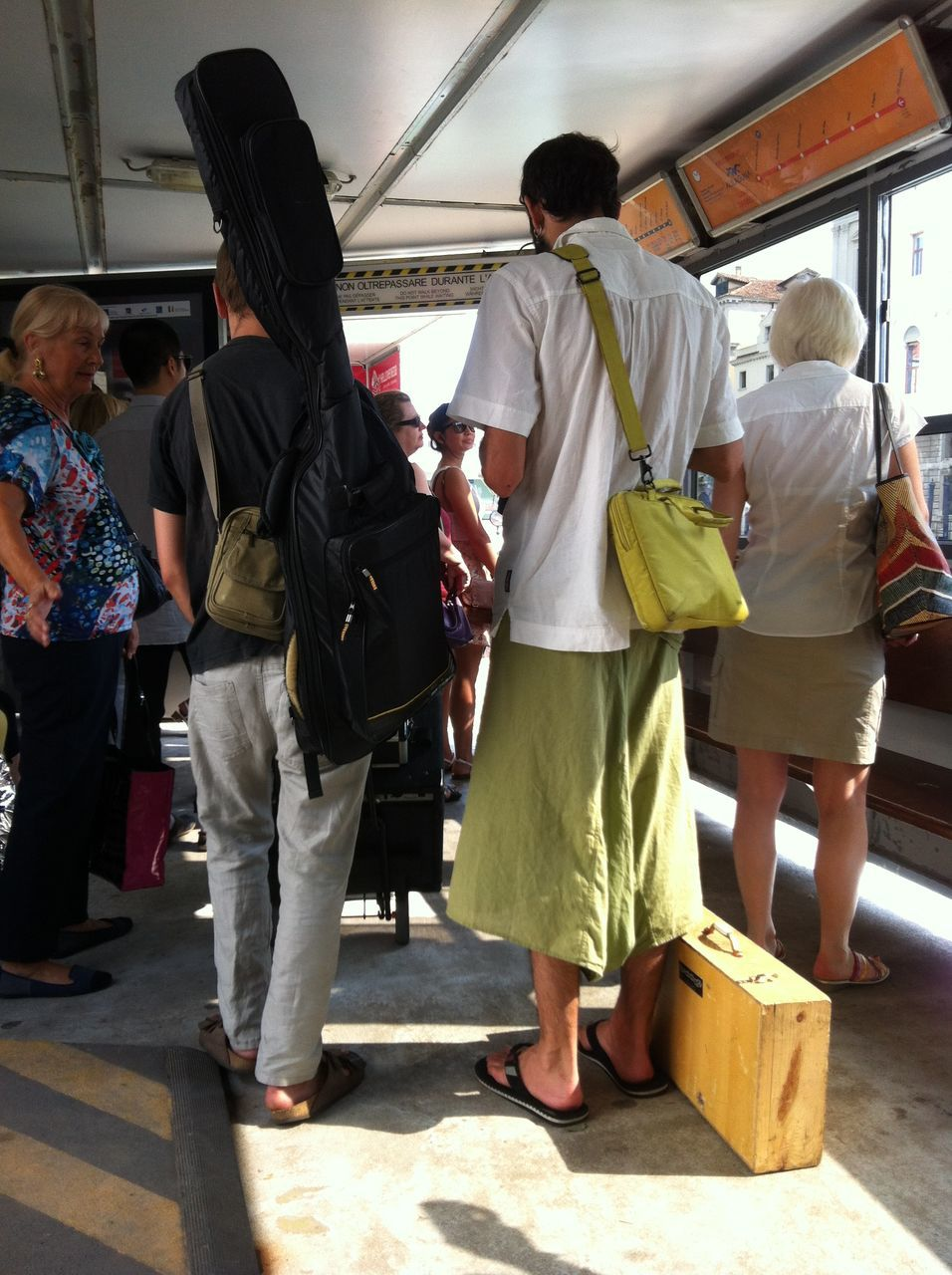 Rear View Of People With Luggage