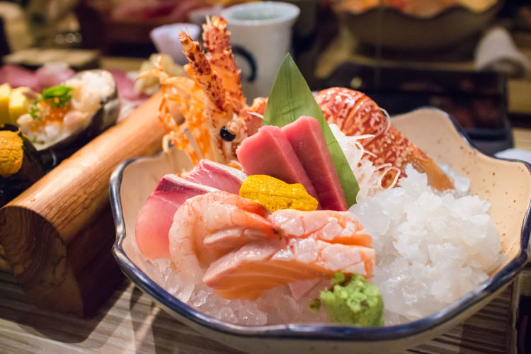 Close-up of sashimi in bowl on table