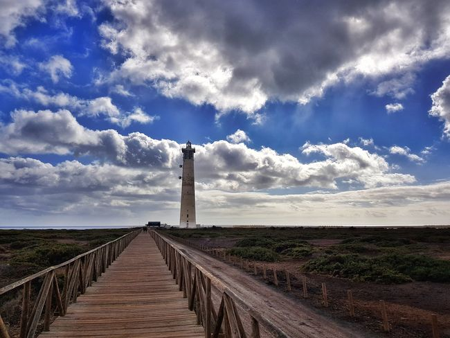Lighthouse of Morro Jable Clouds Smartphonephotography PhonePhotography Mobilephotography Lines EyeEm Selects Cellphonephotography Fuerteventura Lighthouse Cloud - Sky Sky Day Outdoors