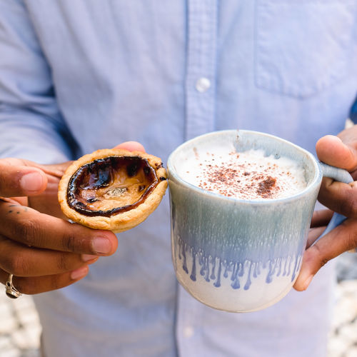 Holding Food And Drink Drink Refreshment Real People Human Hand One Person Hand Focus On Foreground Midsection Freshness Lifestyles Coffee Frothy Drink Human Body Part Coffee - Drink Cup Day Drinking Glass Glass Hot Drink Finger