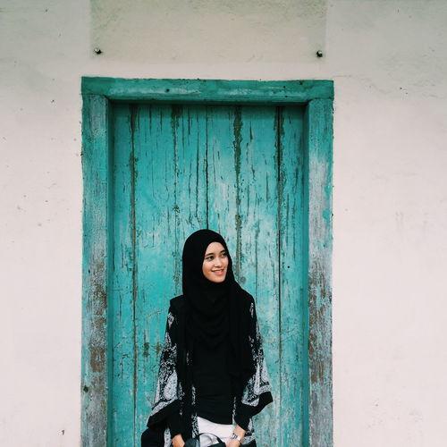Portrait Of Woman Standing In Front Of Door