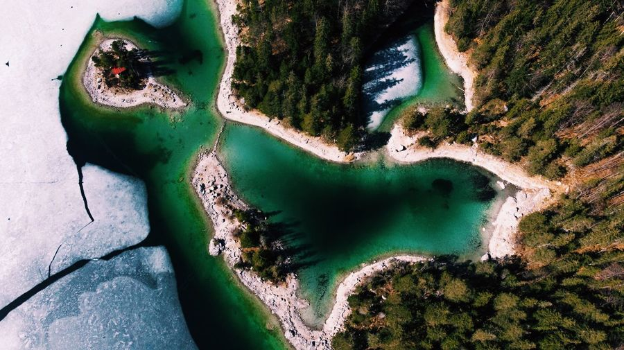 Lake Eibsee Blue Water View From The Top Droneshot Drone Photography Dronephotography Drone  No People Plant Nature Green Color Day High Angle View Outdoors Close-up Growth Beauty In Nature Water Pattern Built Structure Tranquility Sunlight Architecture Tree Lake