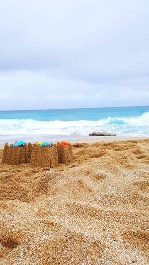 Sea And Sky Sandcastles Cloudy Day Sand Taiwan Kenting, Taiwan Colour Of Life