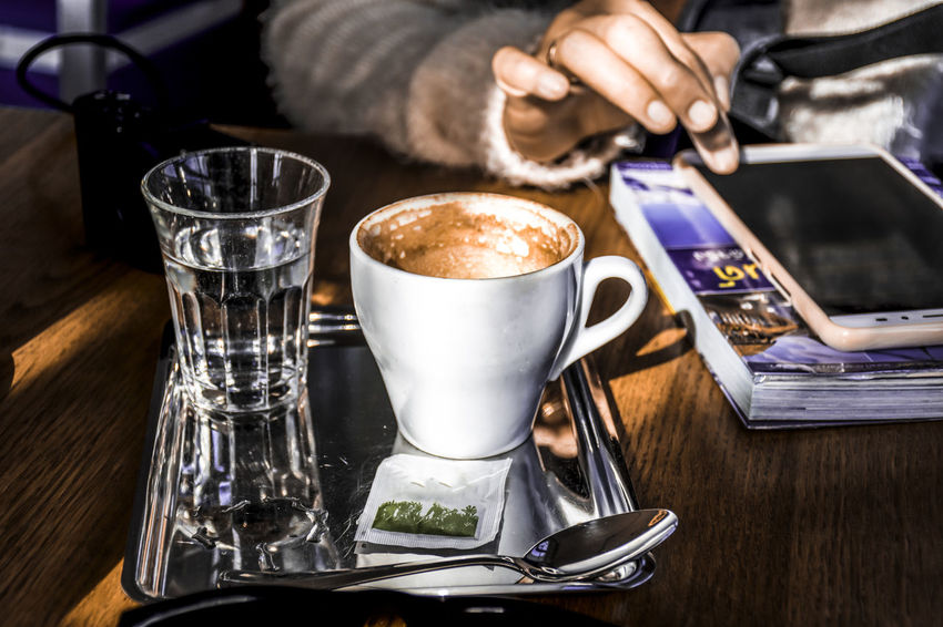 Tourist Travllers Close-up Coffee - Drink Coffee Cup Day Drink Drinking Glass Focus On Foreground Food And Drink Freshness Human Body Part Human Hand Indoors  One Person Real People Refreshment Saucer Table Wireless Technology