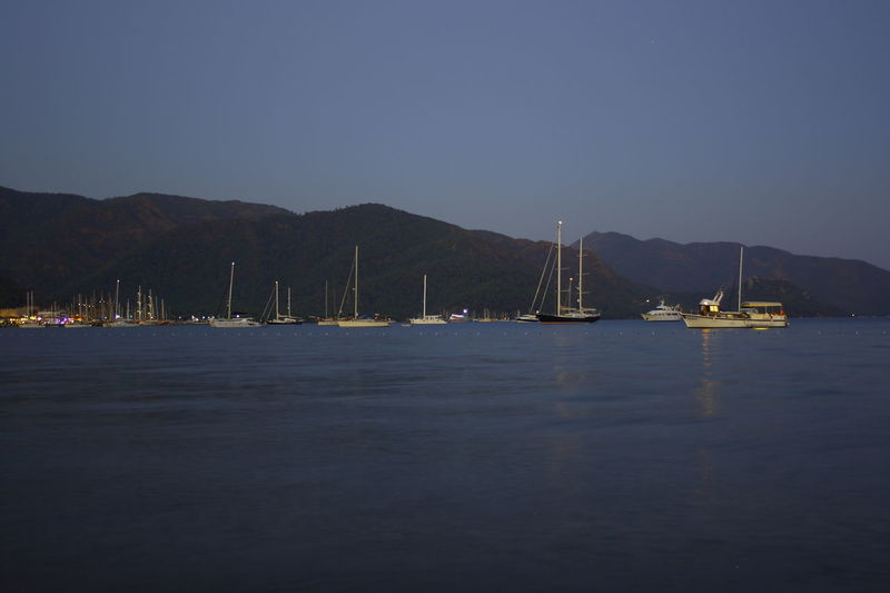 My 3 favorite holiday pictures from Marmaris in Turkey Anchored Bay Beauty In Nature Clear Sky Copy Space Dusk Mode Of Transportation Mountain Nature Nautical Vessel No People Outdoors Sailboat Sailing Sea Sky Tranquil Scene Tranquility Transportation Travel Water Waterfront