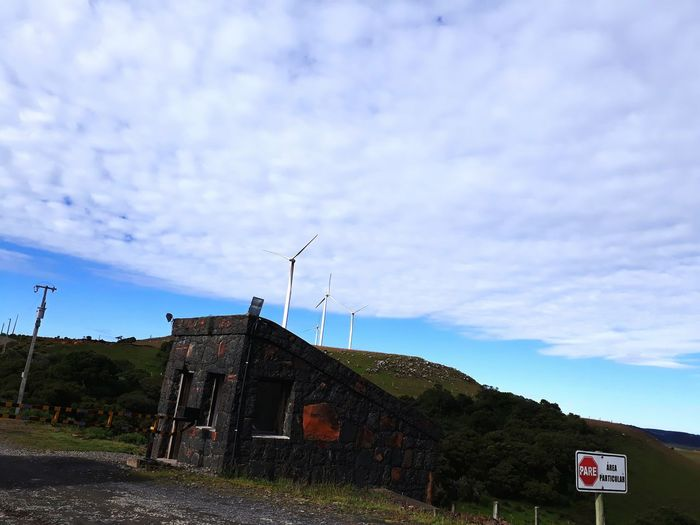 Alternative Energy Wind Turbine Day Nature Sky Traditional Windmill Built Structure Building Exterior Windmill Wind Power House Architecture No People Water Wheel Antenna - Aerial Renewable Energy Watermill Outdoors Military