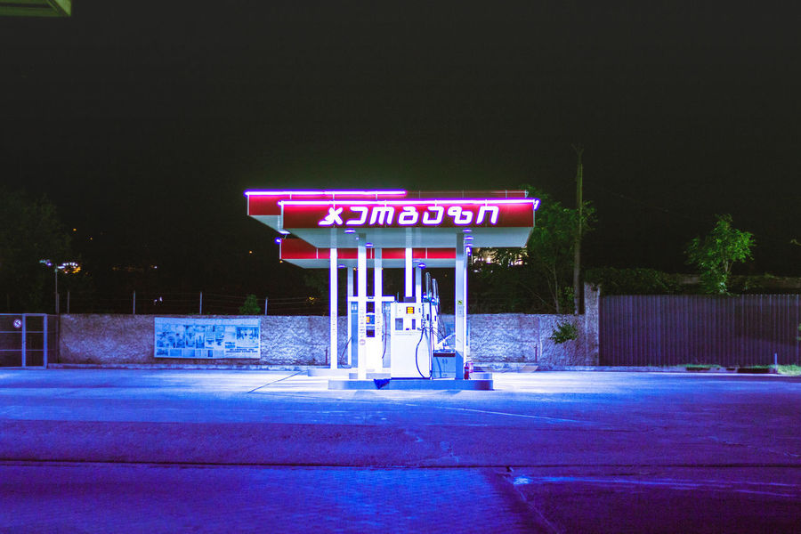 Night Lights Nightphotography Architecture Building Exterior Built Structure Capital Letter City Communication Gas Station Illuminated Information Nature Neon Night Nightlife No People Outdoors Petrol Petrolstation Road Sign Street Text Transportation Western Script