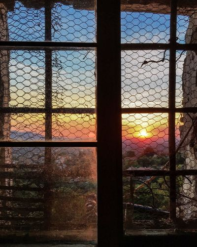 I let a warm sun to set inside, to cast a dark shade at the corner of my window for a while ...hoping that tomorrow it would not frighten a passing little bird to sing a new day song 🌤🐦🍀👣⛰☕️ Sunset Tramonto Italia Window Finestra Abbandonata Abandoned IPhoneography