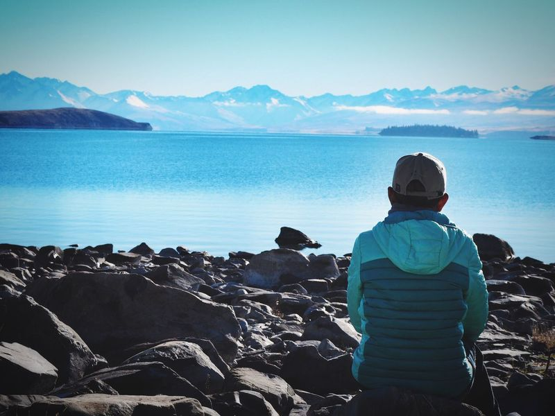 Looking At View Leisure Activity Rear View Beauty In Nature Scenics Sitting Cold Temperature Alone Lonely Enjoy The Silence Enjoy The Nature Warm Clothing Lake Tekapo Be. Ready.