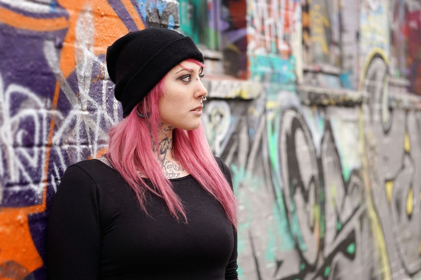 Alternative Authentic Emo Female Gazing Girl Graffiti Inked Leaning Lifestyle Person Pierced Piercing Pink Hair Portrait Real People Serious Street Street Art Tattoo Tattooed Wall Woman Young Adult Young Women