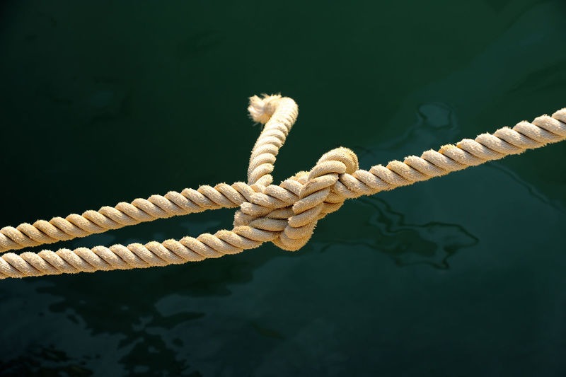 Close-up of rope knot tied on boat