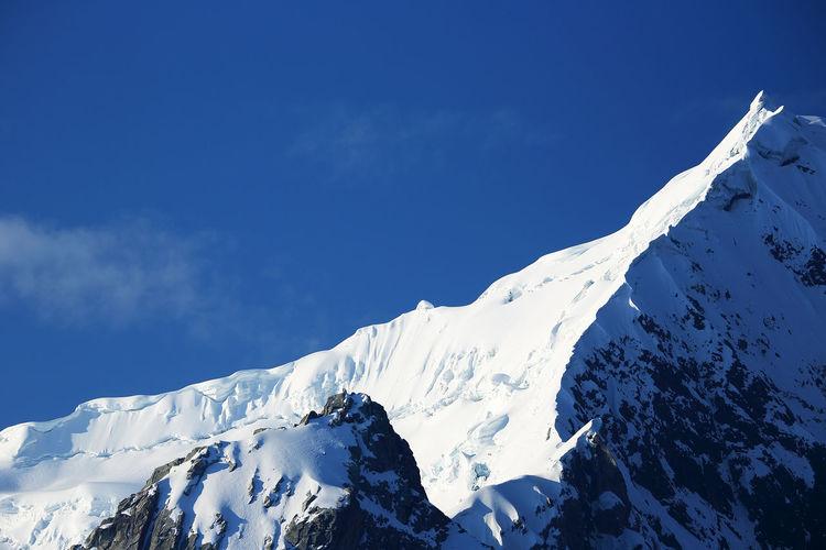 Snow on rocky mountain peak