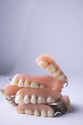 Close-up of dentures against white background