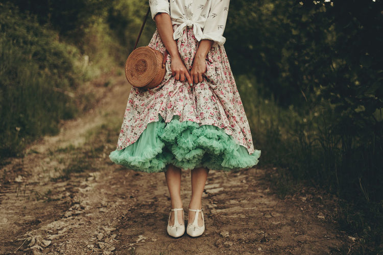 Woman with fluffy skirt  standing on a country path