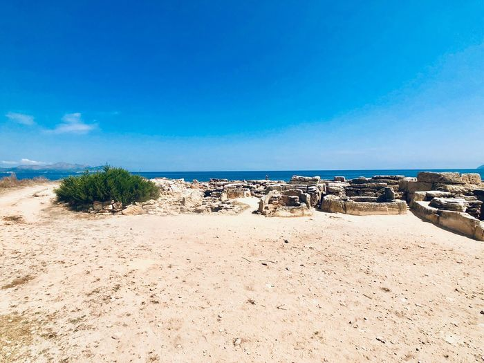 Necropolis Archaeology Archaeological Sites Vacation Mallorca EyeEm Selects Beach Sky Water Blue Land Sea Beauty In Nature Scenics - Nature Tranquility Horizon Over Water Outdoors Copy Space Day No People Nature Sand Idyllic Tranquil Scene Sunlight Horizon