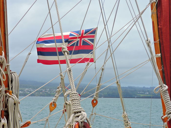 Day Flag Horizon Over Water Independence Mode Of Transportation Nature Nautical Vessel No People Outdoors Patriotism Pole Red Rigging Rope Sailboat Sailing Sea Sky Transportation Water Wind