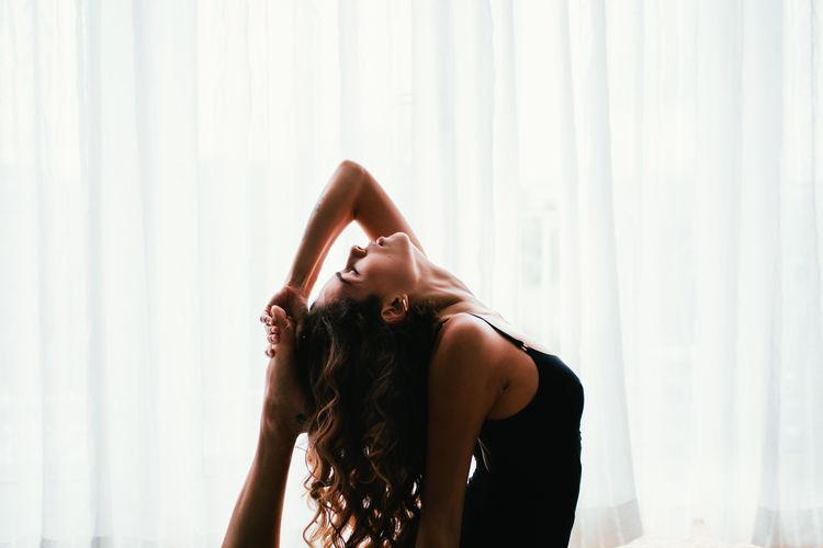 Home Woman Yoga Yoga Pose Curtains Day Fit Fitness Hand In Hair Indoors  Leisure Activity Lifestyles Sport Yoga Practice Yogaeverydamnday Yogagirl Yogi The Week On EyeEm Fresh On Market 2017