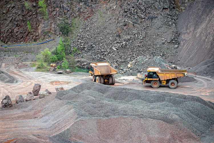 High Angle View Of Trucks At Quarry