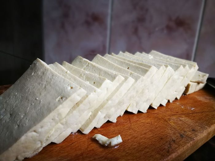 Close-up of tofu on cutting board